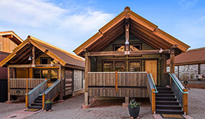 Small 3D image of a bungalow with a wood slat triangular shaped roof at Moab Springs Ranch.