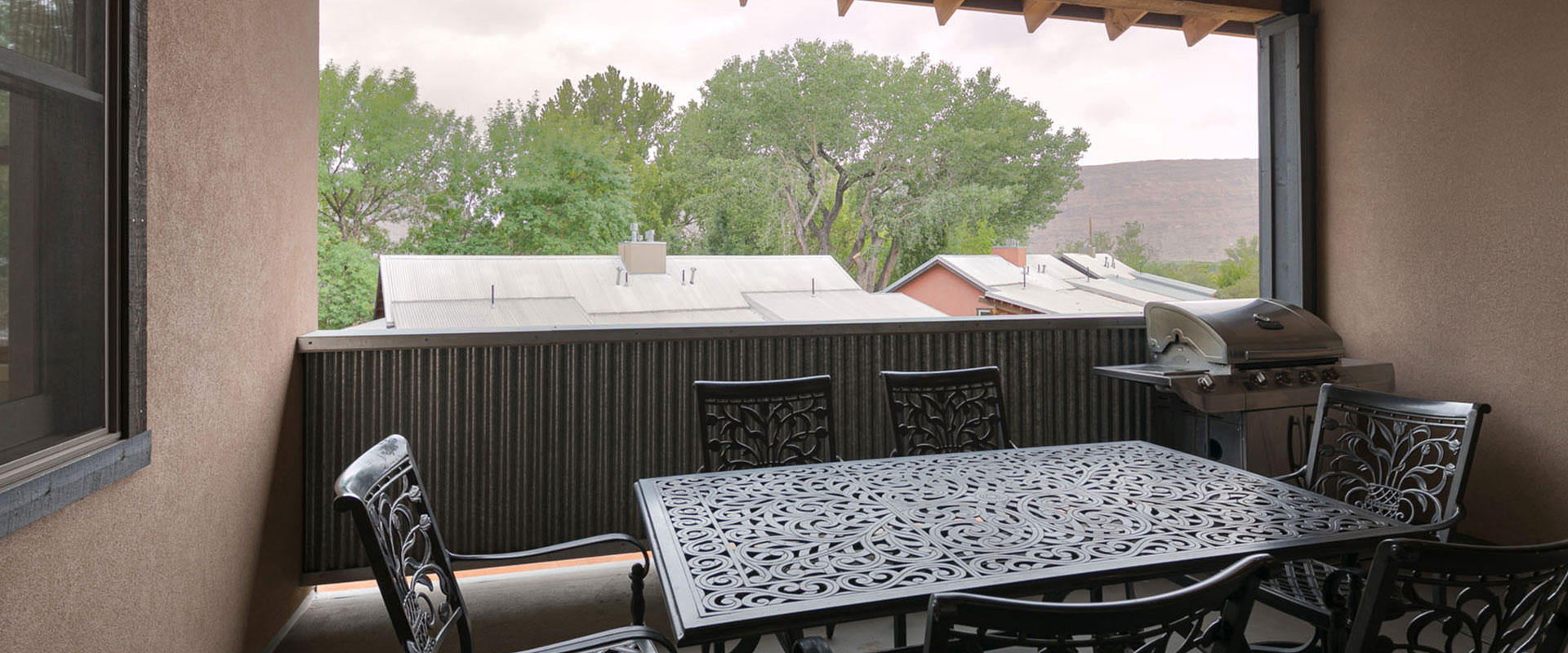 A white spotted lizard is almost camoflaged against an orange beige boulder on which it rests amongst the sandstone cliffs of Moab, Utah.
