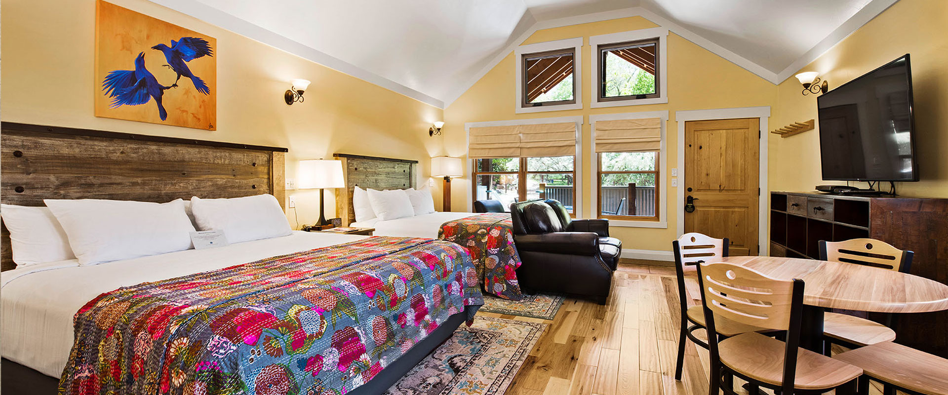 Unit #18 at Moab Springs Ranch features a children's room with a beige wood bunk bed tucked in with multi-colored covers and a turquoise blue shelf stocked with extra bed linen.