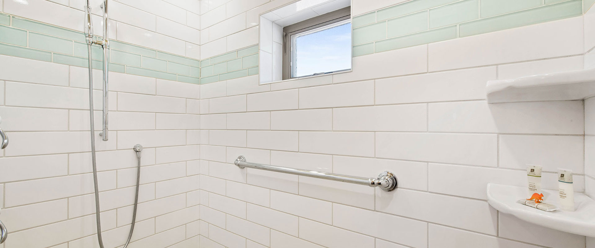 The two car garage space of Unit #17 at Moab Springs Ranch is built with wood and brick posts, with a covered wood deck immediately above it.