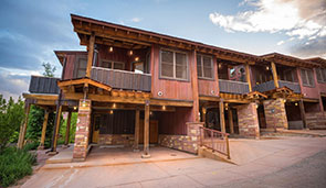 Small image of a brown townhouse unit at Moab Springs Ranch in Utah with a covered balcony and garage.