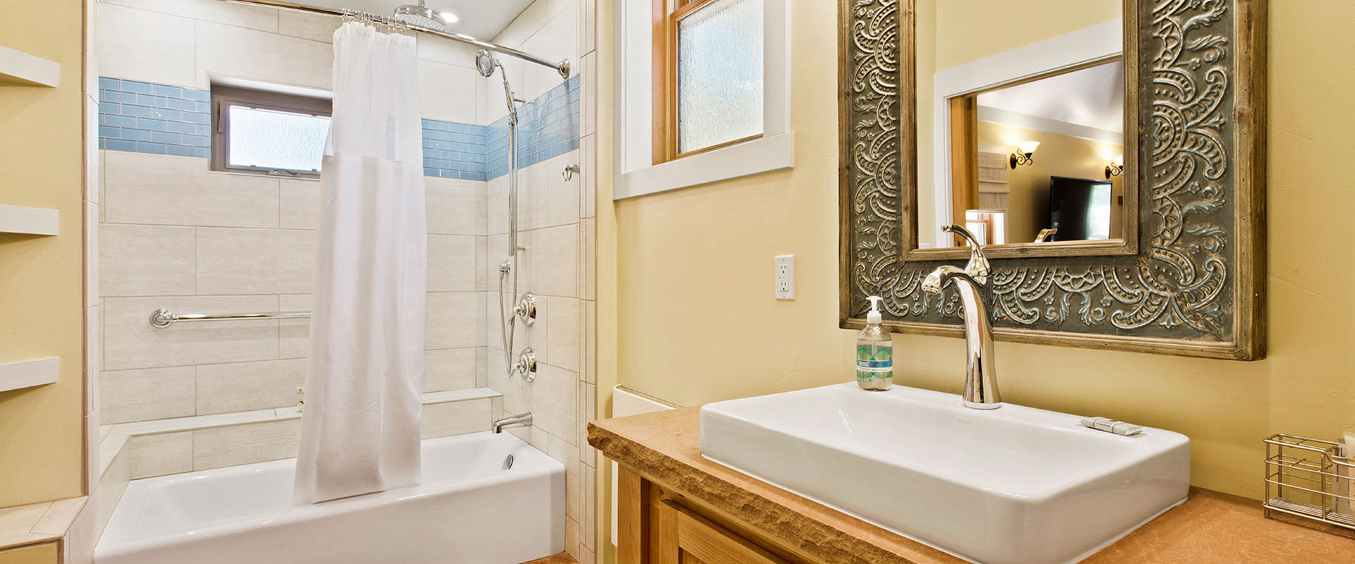 Long wood slats make up the flooring of the balcony of Unit #21 at Moab Springs Ranch with corrugated metal fencing enclosing the area.