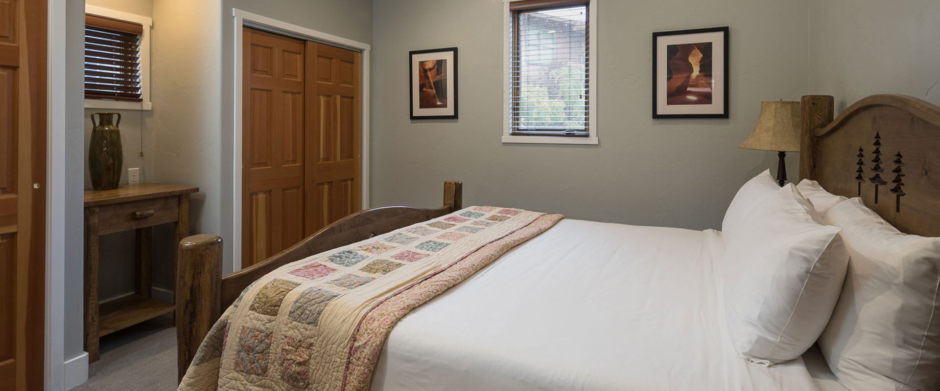 A panoramic view of the vast burnished brown sandstone cliffs, moutains, valley floors and boulders of Moab, Utah.