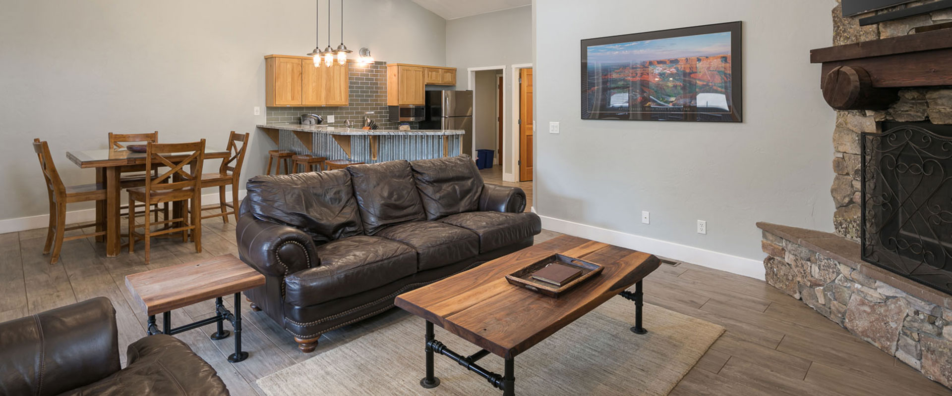 The shadows of visitors hiking on the arid mountain cliffs of Moab, Utah.